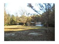 40 wooded acres with a secluded 2001 16x80 mobile home