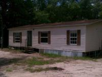 Nice 3bed 2 bath double wide on large lot that backs up