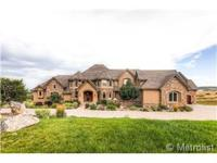 Beautiful Custom Home! Boasts 7 Bedrooms,9 Bathrooms &