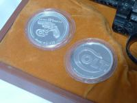 I have two .999 Fine silver rounds commemorating the