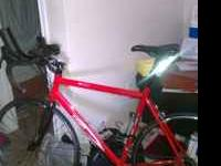 "I have a 2007 red 57"" Scattante road bike for sale."