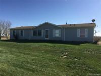 Manufactured home over a full basement on 4.45 acres