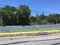 1.69 Acres highly visible Lot on Springdale Rd. Zoned
