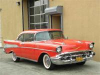 This 1957 Chevrolet Bel Air Coupe . It is equipped with
