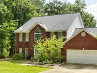 Stunning 3123 sqft home nestled under the trees on the
