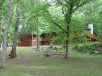 Unique property with 9.5 ac. on Buffalo River. 3500 sq