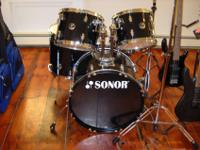 This is a brand new black 5 piece Sonor drum set with a