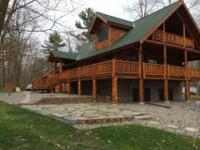 Custom log lake home newly finished, never lived in.