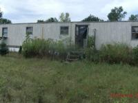 Older mobile home on a  2.75 acre parcel, just west of