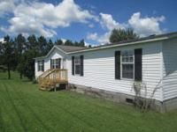 Foreclosed home located at 5741 E. Highway 619 Russell