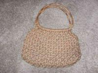 For sale we have a macrame purse/handbag the