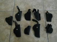 5 Used Leather Holsters, one leather handcuff holder