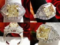 This is a 5CT+ Fancy Yellow Diamond Ring. This diamond