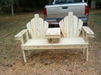 A 5ft bench with a center console made with treated