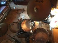 Sitting in my attic I have this 5pc black drum set. It