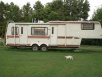"31 ft. 5th. wheel trailer. Needs ""tlc"". Queen size bed,"