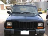 2001 Black Jeep Cherokee Sport for sale. Less than