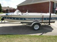 1975 classic Mastercraft Stars and Stripes ski boat.