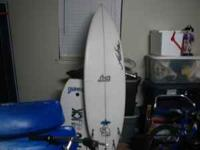 nice surfboard with pad,leash, and bag. 5 finned, 4 are