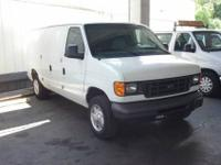 For sale is a white, 2007 Ford E150 cargo - utility