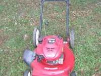 "6.5 Craftsman Lawnmower 21"" cut with large wheels on"