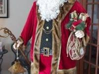 This is a very realistic and impressive Santa.   He is