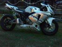 2006 Honda Cbr 600rr with white repsol plastics with