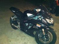 It is a 2006 Gsxr 600, it has M4 street slayer exhaust.