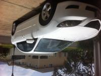 2005 Mazda 3. Sporty White 4 door 4 cylinder automatic