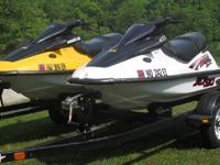 Kawasaki ZXI 1100 jet skis. The yellow one is a 2000