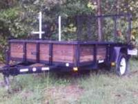 "6'6"" X 10' landscape trailer. New tires, wood deck and"