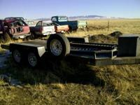Like new tandem axle car trailer with ramps. All steel