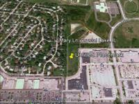 Beautiful 6.9 acre lot separates the Jewel Osco plaza