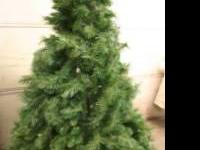 6 foot artificial Christmas tree. Used, in good