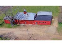 Historic barn and home in visible location! 19 acres of