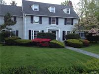 Classic and gracious six-bedroom Center Hall Colonial