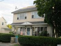 Cape Cod style home currently as a 3 unit. Tenants in