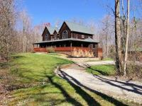 This custom home nestled in the woods will be the
