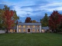 Spectacular country estate situated on 5+ acres w/ huge