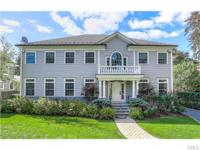 Sun-filled, custom-built colonial is situated in