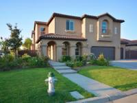 IMMACULATE home located in Tuscan Bluff at Copper River