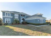 This outstanding 6 bedroom 4.5 bath screened pool home