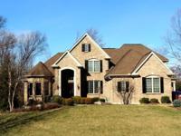 Elegant, prestigious Ivy Trails home offers 6 bds,