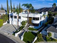This stunning 5,916 sq ft contemporary home w amazing