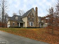 Amazing custom home nestled on 5.63 acres just minutes