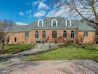Private beautiful custom all-brick home. Exceptional