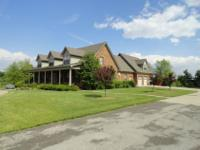 Custom designed home sitting on 6+ beautiful acres with