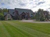 Escape to this scenic estate nestled on 37 acres of