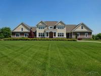 Nestled on 3.1 acres in Chestnut Ridge Subdivision in