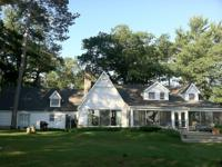 Classic lake home on a sprawling 6.5 acre estate. This